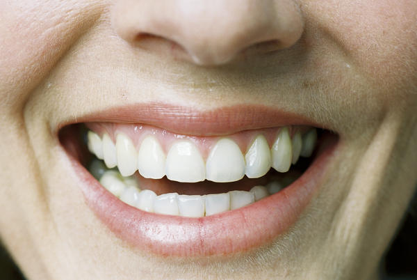 What causes a small lump on the upper gum and small tiny lumps on the lower gums?