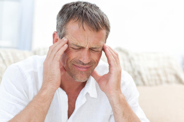 What can cause a sudden excruciating 1-second headache accompanied by lightheadedness?