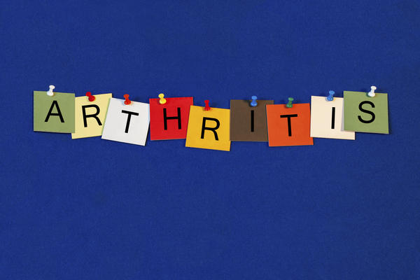 What is arthritis and wht r its symptoms?