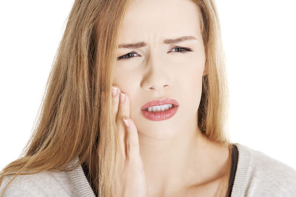 What are the most common causes in disorders of the TMJ  specifically when a patient has pain when trying to open widely the lower jaw?