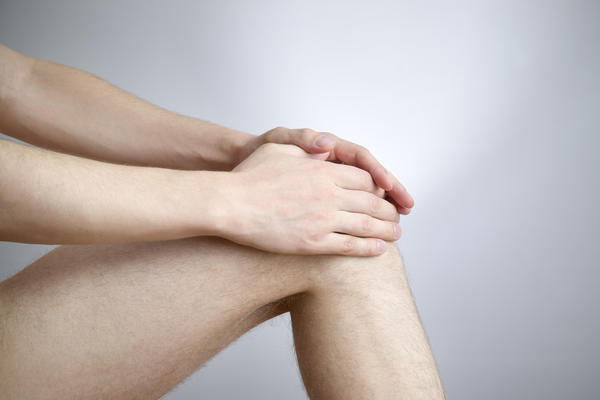 How do you treat a sprained knee?