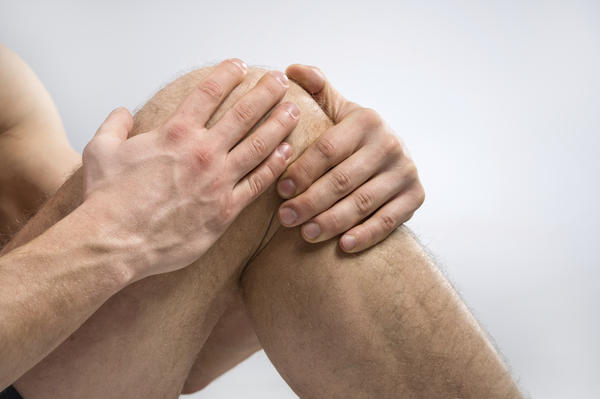 What can I do for a swollen, painful knee cap?
