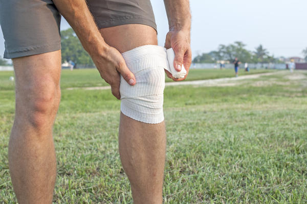 What happens to torn ligaments during knee replacement surgery?