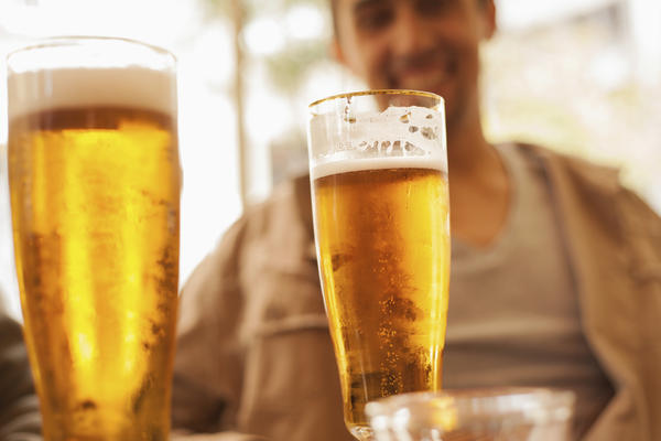 Does alcohol raise or lower one's blood pressure?