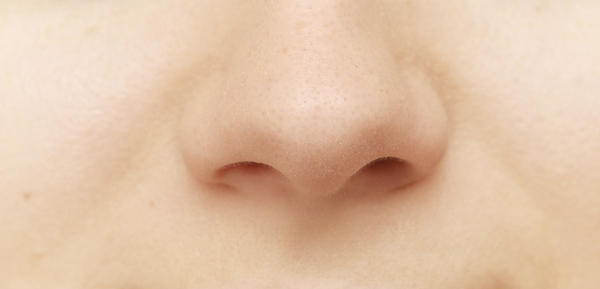 The tip of my nose is really tender, warm, and slightly swollen. it's Hard like there is extra cartilage growing. my nose looks huge. septum, lat.crus?