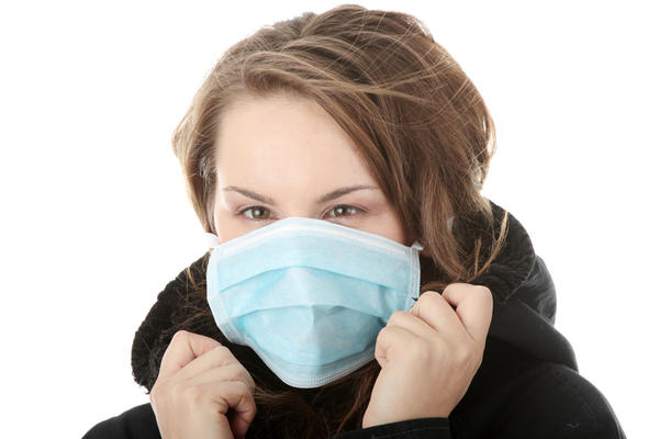 What are the symptoms of bronchiectasis?