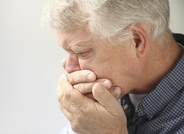 Can a regular headache cause nausea and vomiting?