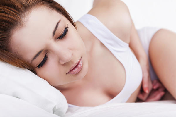 What is the cause of stomach pains and nausea during early pregnancy?