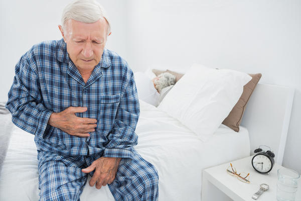 Pain in lower stomach in men. What can cause that?