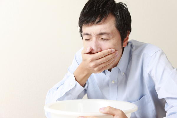 What is when you throw up after eating certain foods or certain amounts and constantly spitting?