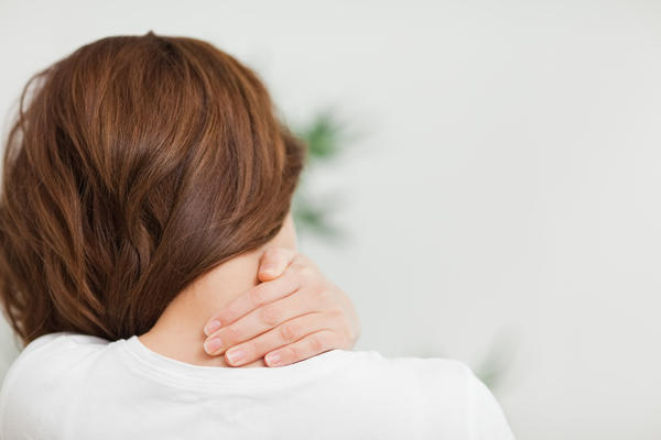 How can you ease the pain of severe neck cramping?