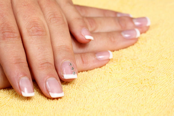 What can cause fingernails and toenails to turn blue?