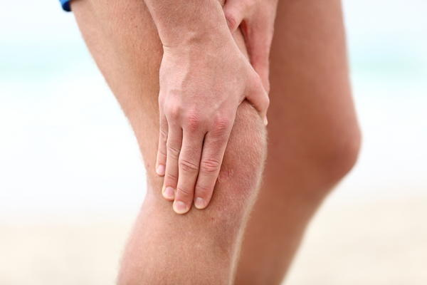 I have a sore muscle in my thigh above my knee. It is tender to the touch & sore when walking.  Aches at times when sitting.Any concern of blood clot?