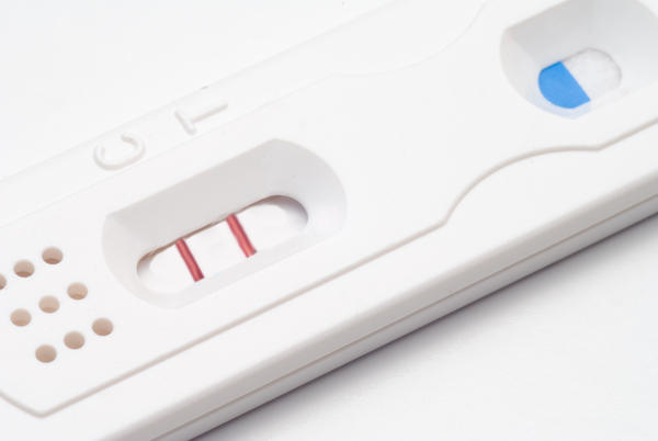 How many weeks until a pregnancy test can show up positive or  negative? And how early can you show signs of being pregnant ?