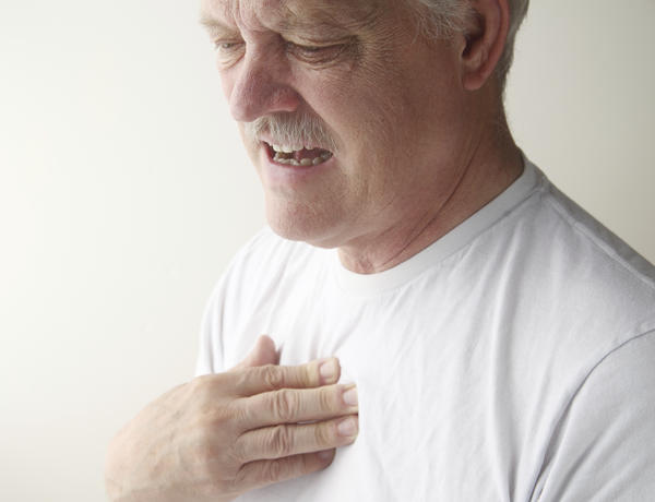 What are the causes of infrequently occurring (~monthly) central chest pain (tight, pressure) + difficulty breathing that lasts for ~1min - comes about spontaneously, including at rest?