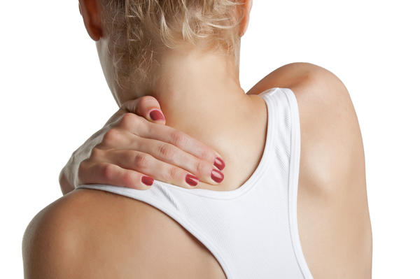 How can I release the tension in my shoulder blade?