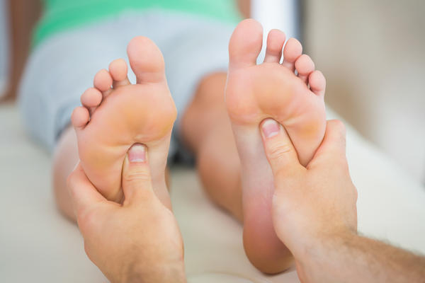 Besides plantar fascitis, what are some painful conditions that feet can get partly because they didn't stretch enough?