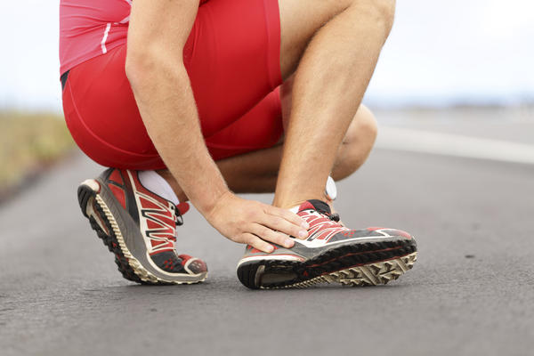 What is the treatment for ankle sprain?