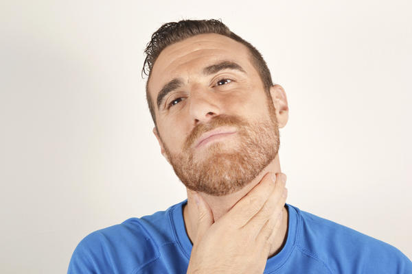 What should gargling with salt water do for a sore throat?