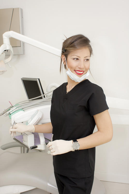 Where should I contact for my dental care while I am out of the country?