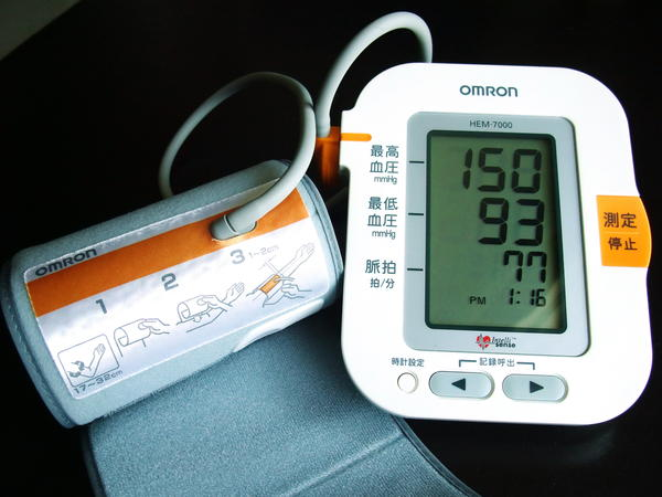 What could be causing high blood pressure and low pulse in a fit person?