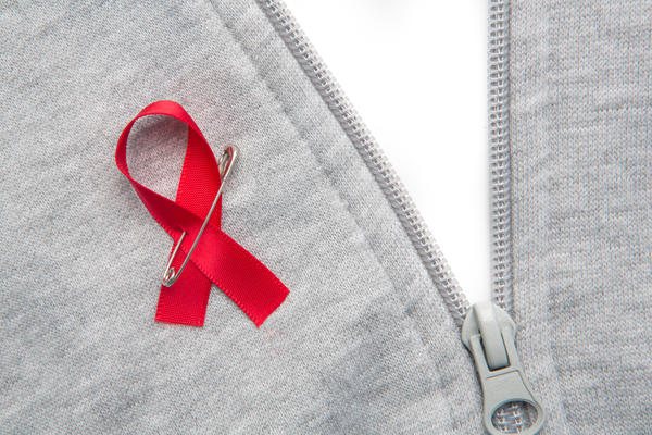 Do HIV cause lesions on penis?