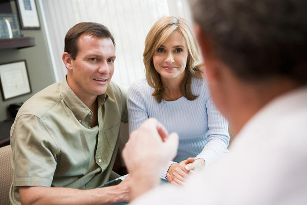 What should my husband expect during his first infertility visit?