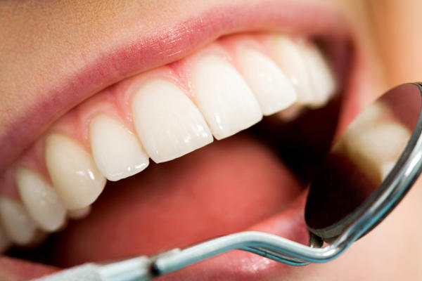 How long to recover from gingivitis? At my dentist appointment the other day, when my dentist measured my gum depth, there were several that came in at five. Can I do anything at home between now and six months from now when i go to the dentist next to fi