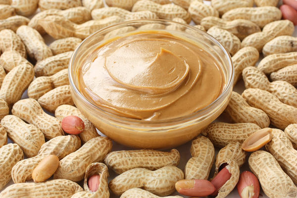 After eating peanut butter, I have burning eyes, throat/eye swelling, low blood pressure, blurred vision. I have eaten it since a child so no allergy
