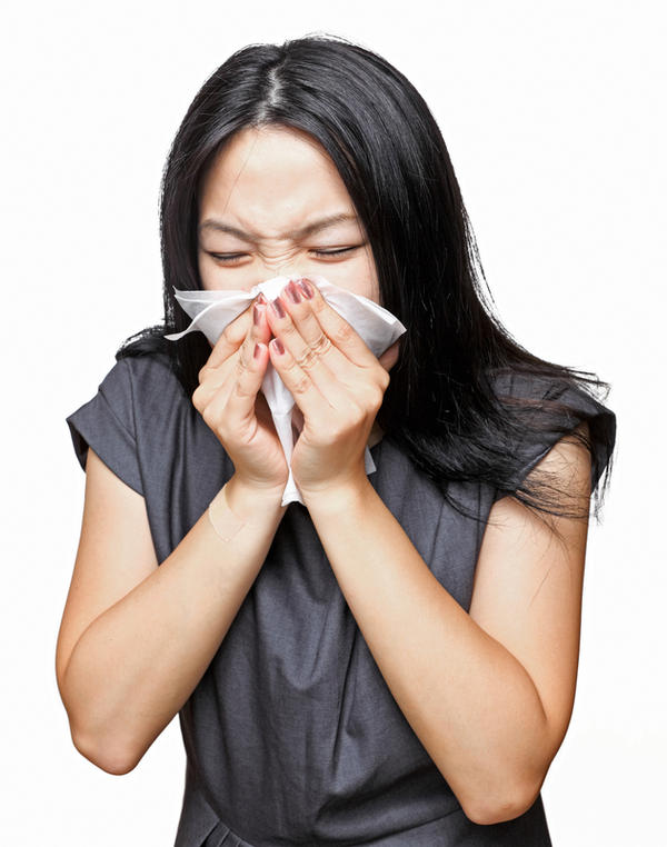 When I cough, I cough up clear mucus with little light brown specks all through it what is it ?