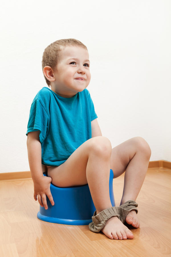 What causes the presence of fat in a child's stool?