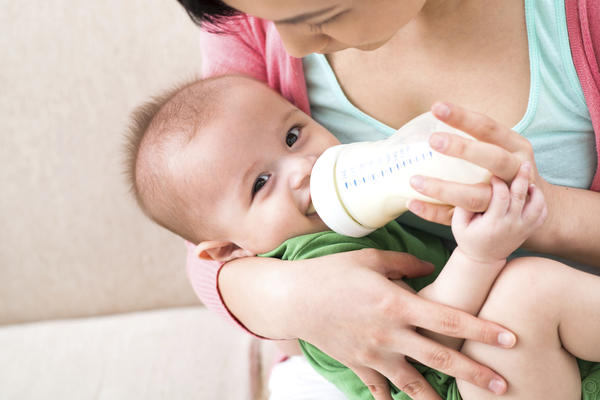 How can I balance breastfeeding on demand and weaning my infant off of breast milk?