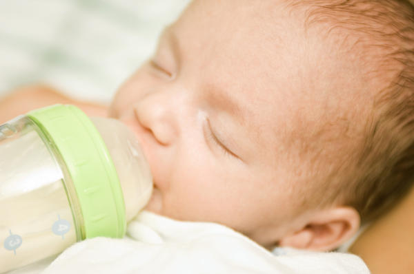 Besides burping, what can I do to feed my restless baby?
