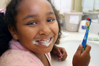 african american bathroom bedtime brush brushes brushing child clean cleaning cleans color colorful colors colour colourful colours evening female girl home kid morning mouth multi racial red ritual s sink teeth toothbrush toothbrushing toothpaste yellow young Teething Teeth Wisdom Teeth Tooth Extraction