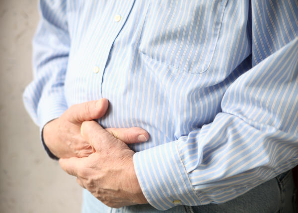 Why do people vomit with a bowel obstruction?