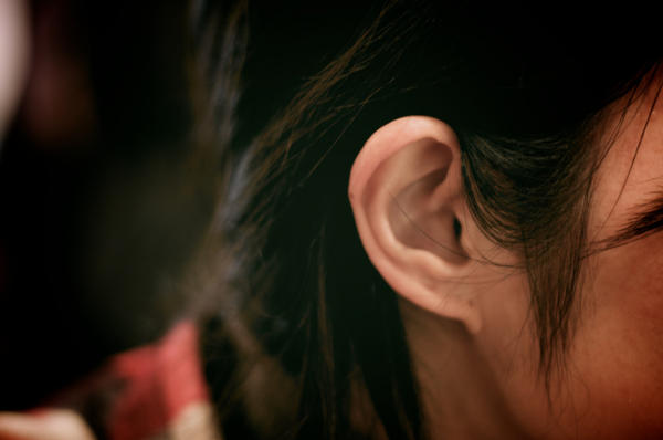 What do I do if I see a discharge from my child's ear?