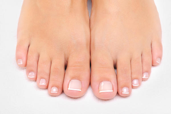 How long does a bruised toe nail last?