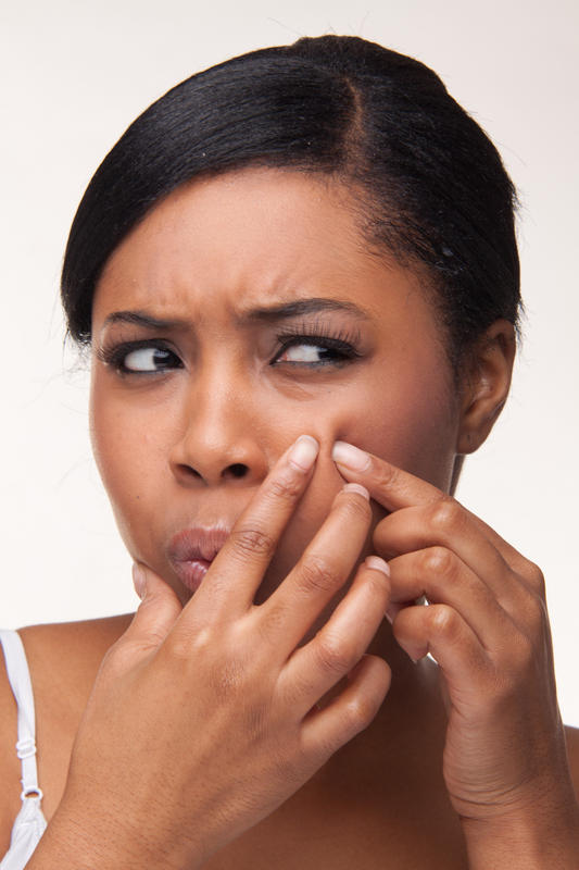 What can you do to stop a pimple from starting to appear on your face?