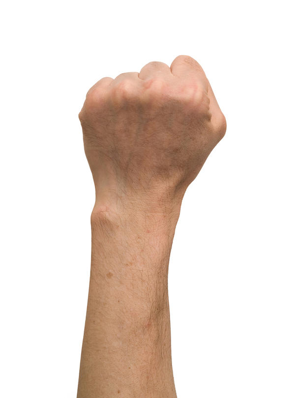 Can i drain a dorsal wrist ganglion on my own?