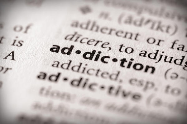 What is the medical definition of addiction versus dependence?
