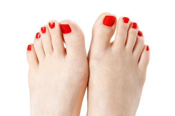 What should I do if I have inflamed and itchy spots in the centers of each of my big toes. Help?
