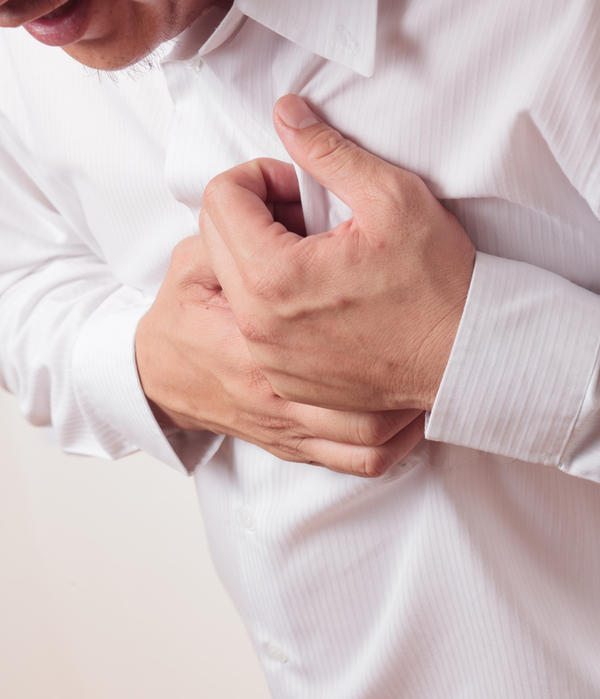 Sharp dull Chest pain out of no where at times when bending over and when lifting arms or just sitting. .