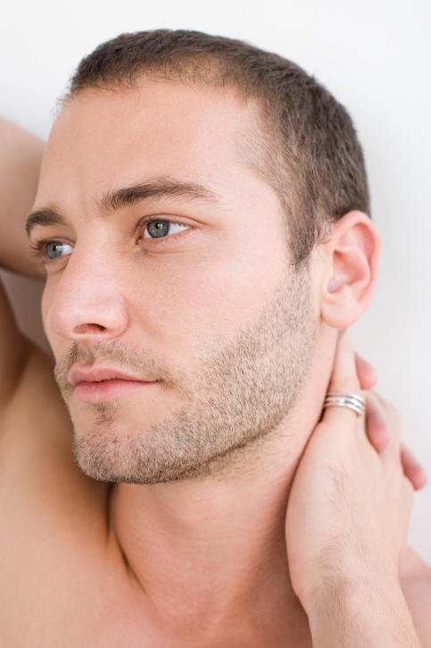 What could slow the rate of facial hair growth in men?