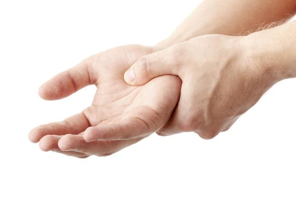What can cause wrist stiffness and stifness in hand, along with numbing and tingling sensations in arm?