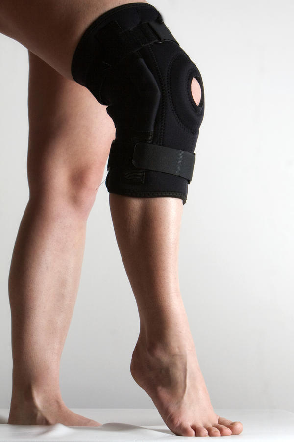 How would wearing a knee-brace help with a pinched meniscus?