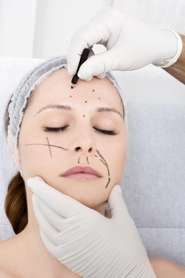 Can plastic surgery lower ones high forehead?