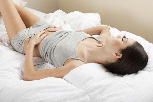 I have spotting after a 19 day long menstrual period, what does it mean?