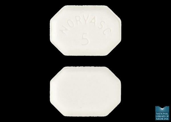 What time of the day or night should I take my Norvasc (amlodipine) tablet (5 mg) for maintainenance of blood pressure?