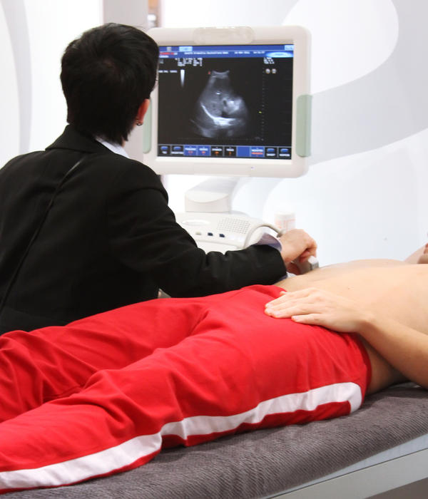 Are there any fetal risks to an abdominal ultrasound examination?