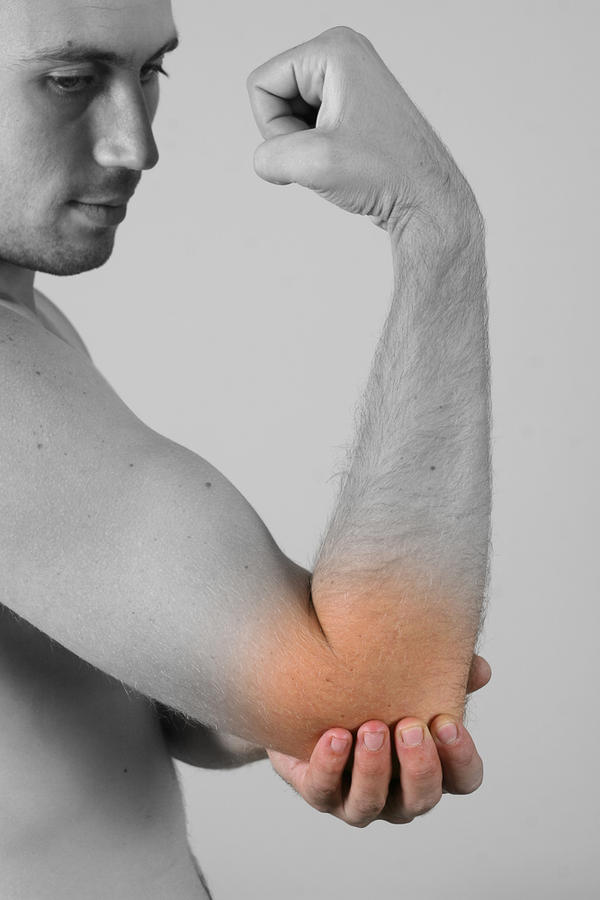 What do I do to get rid of my chronic elbow pain from old sports injury?
